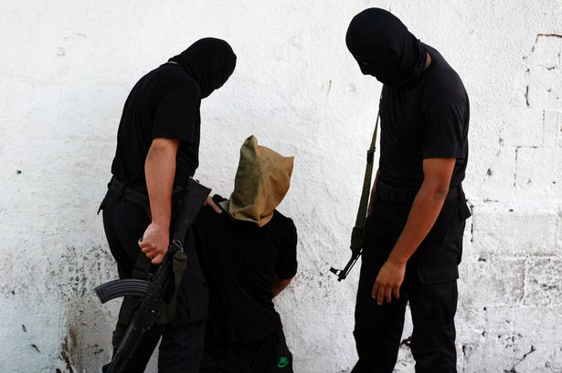 Harrowing: Militants with Palestinian before execution